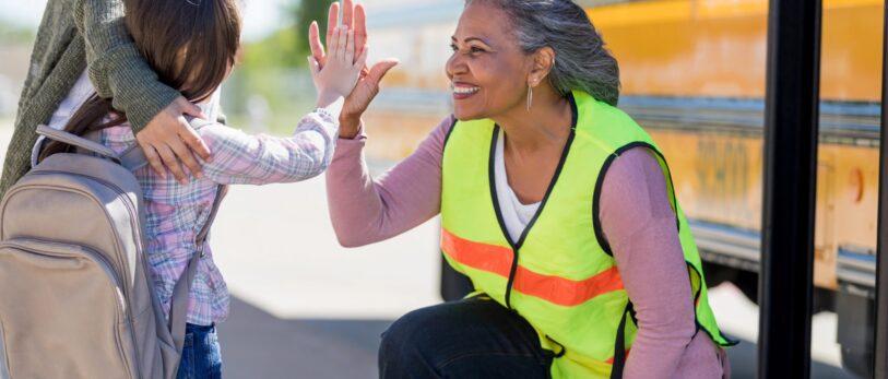 Senior Female Bus Driver High-fives Student_blog
